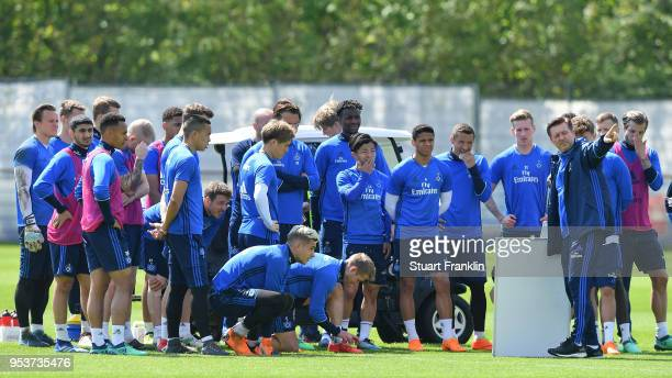 Christian Titz head coach of Hamburger SV shows this players a tactic board during the training session of Hamburger SV at Volksparkstadion on May 2...