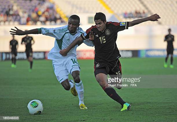 Christian Tovar of Mexico is challenged by Chidiebere Nwakali of Nigeria during the FIFA U17 World Cup group F match between Mexico and Nigeria at...