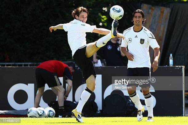 Christian Traesch and Sami Khedira of Germany exercise during a training session ahead of their UEFA EURO 2012 qualifying match against Austria on...