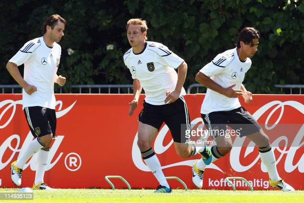 Christian Traesch, Benedikt Hoewedes and Sami Khedira of Germany run during a training session ahead of their UEFA EURO 2012 qualifying match against...