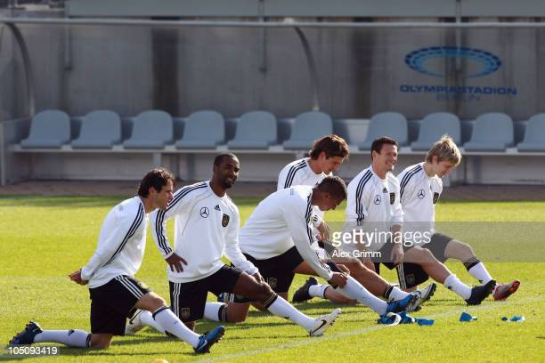Christian Traesch Cacau Jerome Boateng Mario Gomez Sascha Riether and Marko Marin exercise during a training session of the German national football...