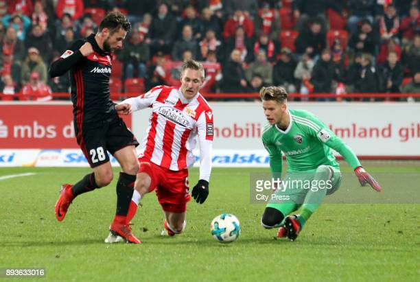 Christian Traesch of FC Ingolstadt 04 and Sebastian Polter of 1FC Union Berlin and Oerjan Nyland of FC Ingolstadt 04 during the game between Union...