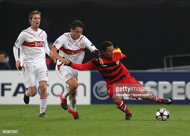 Christian Traesch of Stuttgart and his team mate Aleksander Hleb battle for the ball with Adriano of Sevilla during the UEFA Champions League Group G...