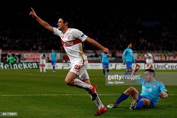 Christian Traesch of Stuttgart celebrates his team's second goal as Valeriu Bordeanu of Unirea reacts during the UEFA Champions League Group G match...