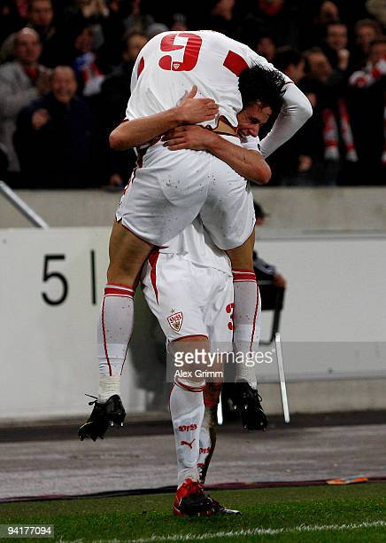 Christian Traesch of Stuttgart celebrates his team's second goal with team mate Ciprian Marica during the UEFA Champions League Group G match between...