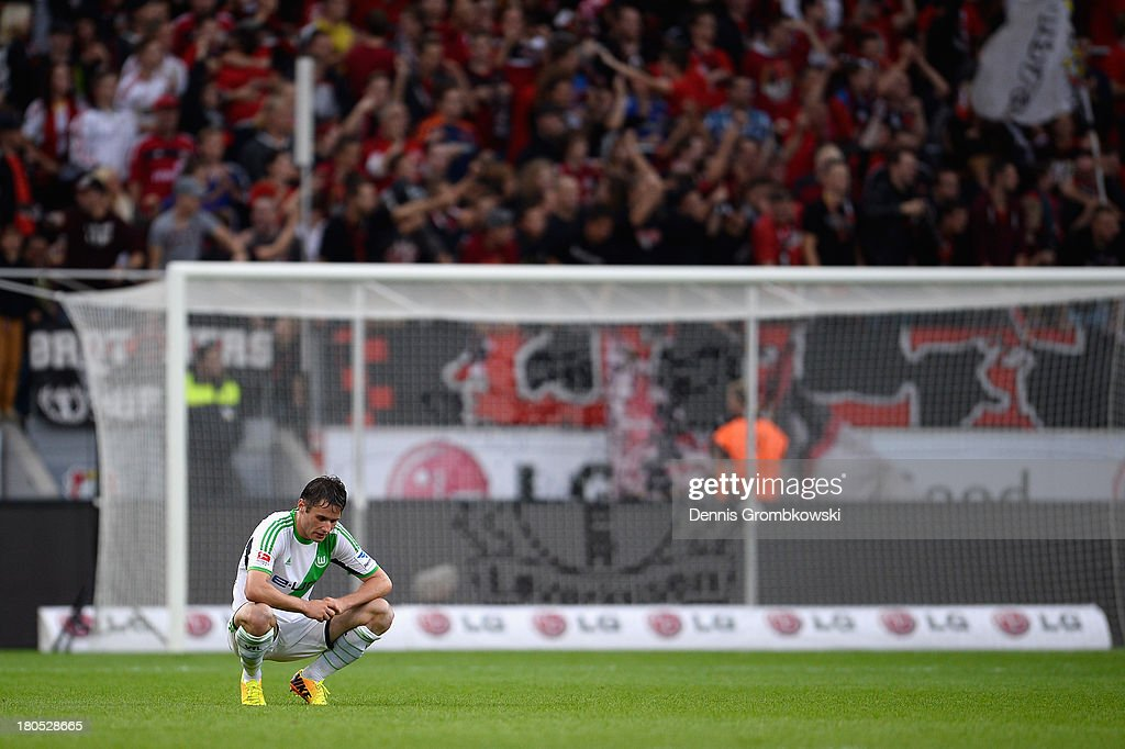 Christian Traesch of VfL Wolfsburg shows his frustration after the Bundesliga match between Bayer 04 Leverkusen and VfL Wolfsburg at BayArena on September 14, 2013 in Leverkusen, Germany.
