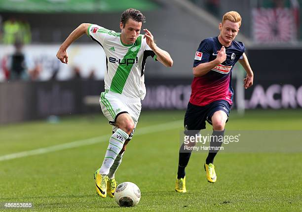 Christian Traesch of Wolfsburg and Sebastian Kerk of Freiburg challenge for the ball during the Bundesliga match between VfL Wolfsburg and SC...