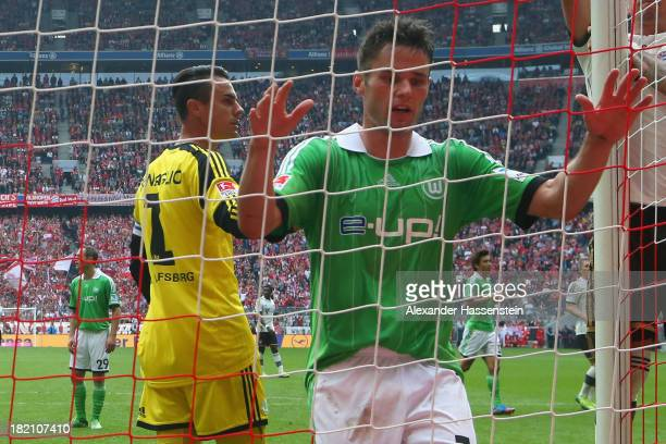 Christian Traesch of Wolfsburg reacts with his keeper Diego Benaglio during the Bundesliga match between FC Bayern Muenchen and VfL Wolfsburg at...