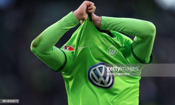 Christian Traesch of Wolfsburg takes off his jersey after the Bundesliga match between VfL Wolfsburg and SV Darmstadt 98 at Volkswagen Arena on March...