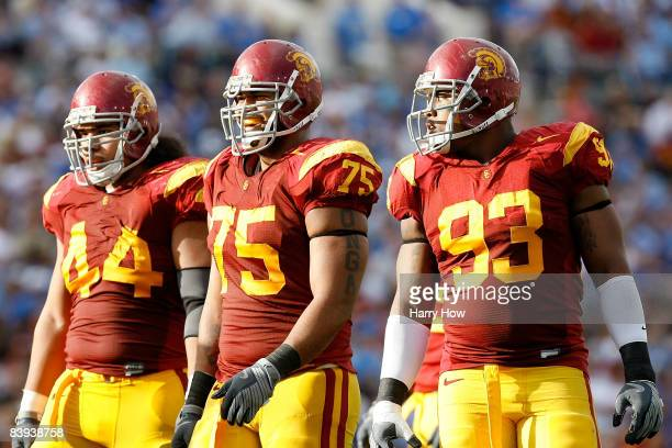 Christian Tupou, Fili Moala and Everson Griffen of the USC Trojans smile during the first half against the UCLA Bruins on December 6, 2008 at the...