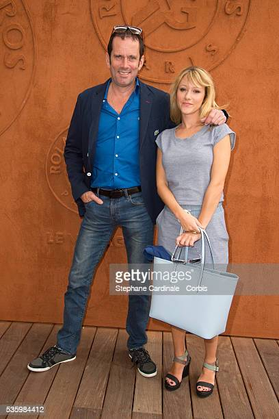 Christian Vadim and Julia Livage attend the Roland Garros French Tennis Open 2014