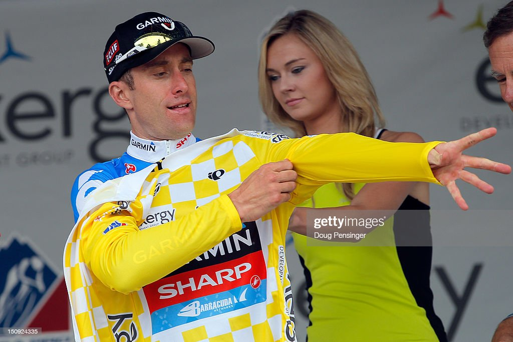 Christian Vande Velde of the USA riding for Garmin-Sharp puts on the race leader's yellow jersey after earning it in stage three of the USA Pro Challenge from Gunnison to Aspen on August 22, 2012 in Aspen, Colorado.