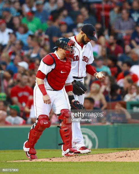 Christian Vazquez and David Price of the Boston Red Sox talk as they walk back to the mound during the game against the Los Angeles Angels at Fenway...