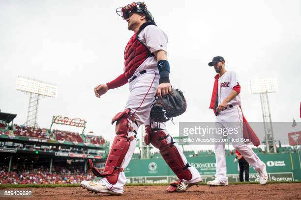 Christian Vazquez and Rick Porcello of the Boston Red Sox walk toward the dugout before game four of the American League Division Series against the...