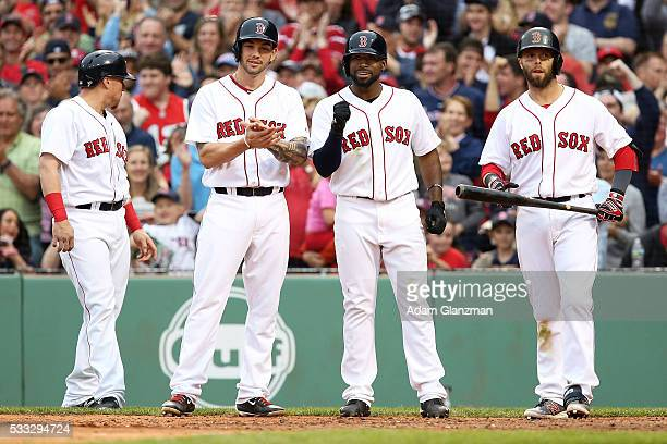 Christian Vazquez Blake Swihart Jackie Bradley Jr #25 and Dustin Pedroia wait for Mookie Betts of the Boston Red Sox at home plate after he hit a...