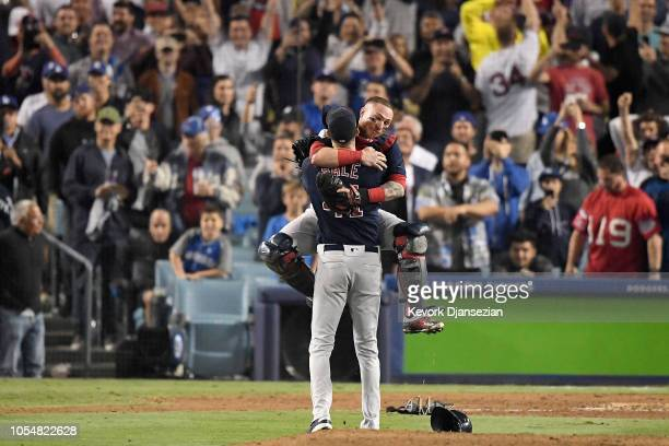 Christian Vazquez jumps into the arms of Chris Sale of the Boston Red Sox to celebrate their 5-1 win over the Los Angeles Dodgers in Game Five to win...