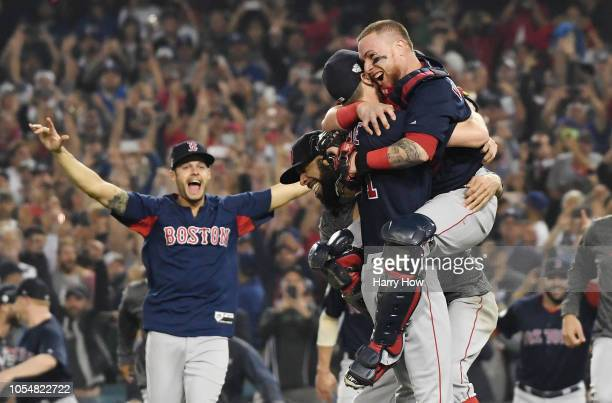 Christian Vazquez jumps into the arms of Chris Sale of the Boston Red Sox to celebrate their 51 win over the Los Angeles Dodgers in Game Five to win...