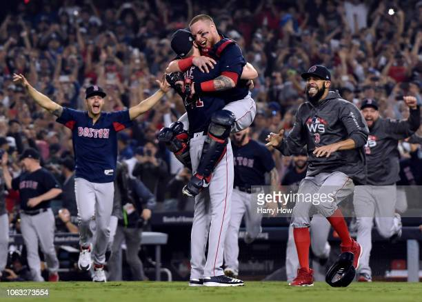 Christian Vazquez jumps into the arms of Chris Sale of the Boston Red Sox as starting pitcher David Price approaches the mound to celebrate their 51...