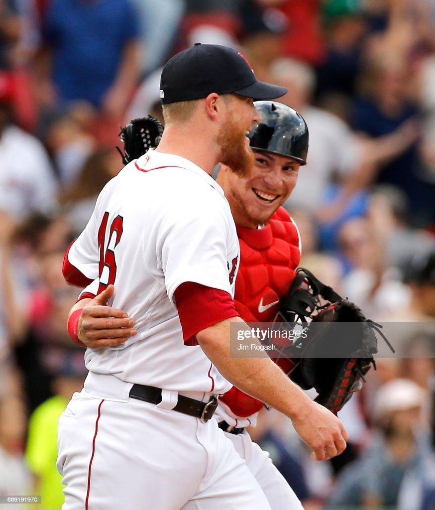 Christian Vazquez #7 of the Boston Red Sox and Craig Kimbrel #46 of the Boston Red Sox react after a win over the Tampa Bay Rays at Fenway Park on April 16, 2017 in Boston, Massachusetts.