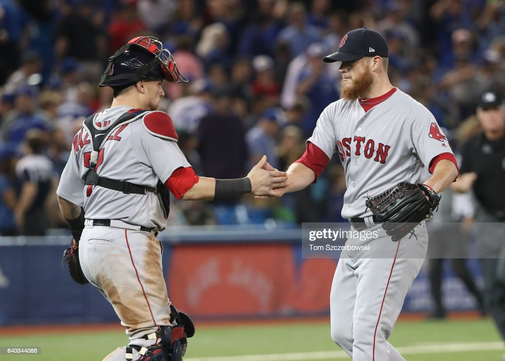 Christian Vazquez #7 of the Boston Red Sox celebrates a victory with Craig Kimbrel #46 after MLB game action against the Toronto Blue Jays at Rogers Centre on August 28, 2017 in Toronto, Canada.
