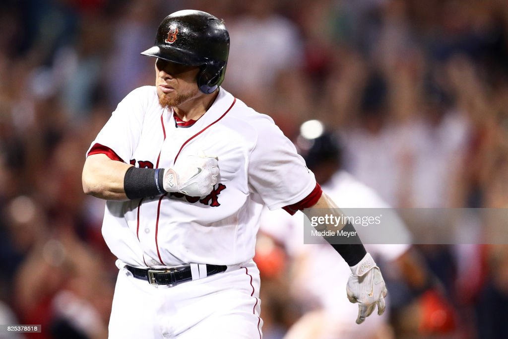 Christian Vazquez #7 of the Boston Red Sox celebrates after hitting a three run homer in the ninth inning to defeat the Cleveland Indians 12-10 at Fenway Park on August 1, 2017 in Boston, Massachusetts.