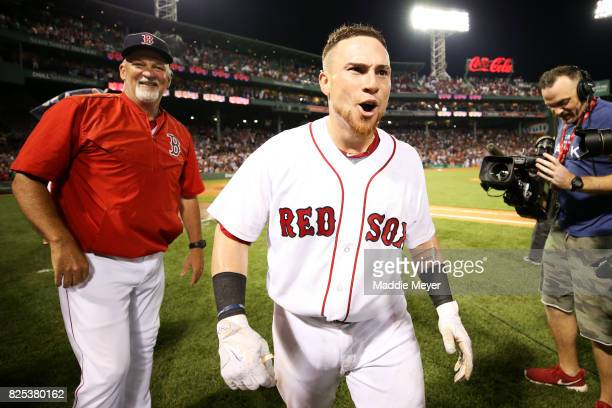 Christian Vazquez of the Boston Red Sox celebrates with pitching coach Carl Willis after hitting a three run homer in the ninth inning to defeat the...