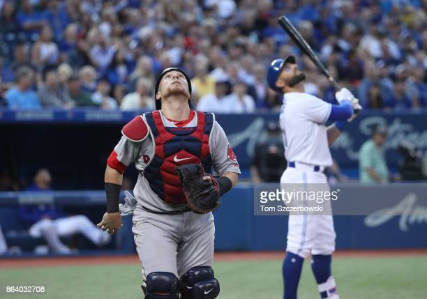 Christian Vazquez of the Boston Red Sox chases a foul pop up before it is caught by Mitch Moreland in the first inning during MLB game action as...