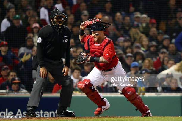 Christian Vazquez of the Boston Red Sox chases after a wild pitch during Game 1 of the ALCS against the Houston Astros at Fenway Park on Saturday...