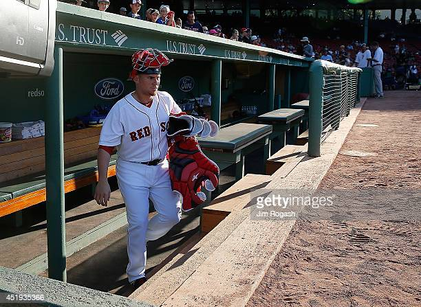 Christian Vazquez of the Boston Red Sox heads to the bullpen to warm up pitcher Rubby De La Rosa before a game with the Chicago White Sox at Fenway...