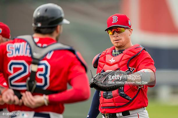 Christian Vazquez of the Boston Red Sox high fives Blake Swihart during a team workout on March 3 2016 at Fenway South in Fort Myers Florida