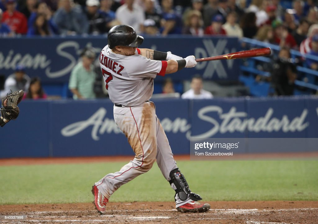 Christian Vazquez #7 of the Boston Red Sox hits a two-run home run in the seventh inning during MLB game action against the Toronto Blue Jays at Rogers Centre on August 28, 2017 in Toronto, Canada.