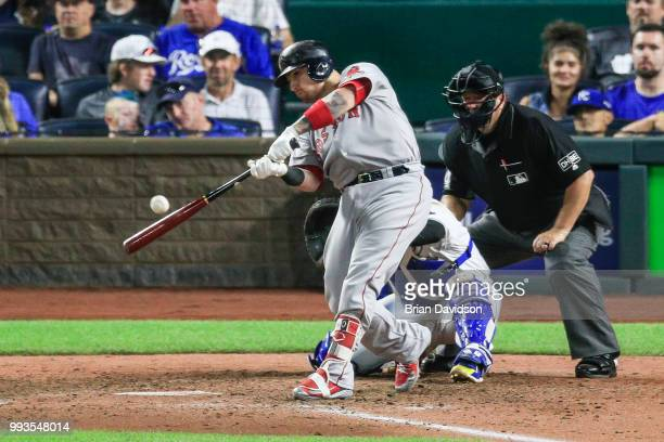 Christian Vazquez of the Boston Red Sox hits the ball to drive in two runs against the Kansas City Royals during the seventh inning at Kauffman...
