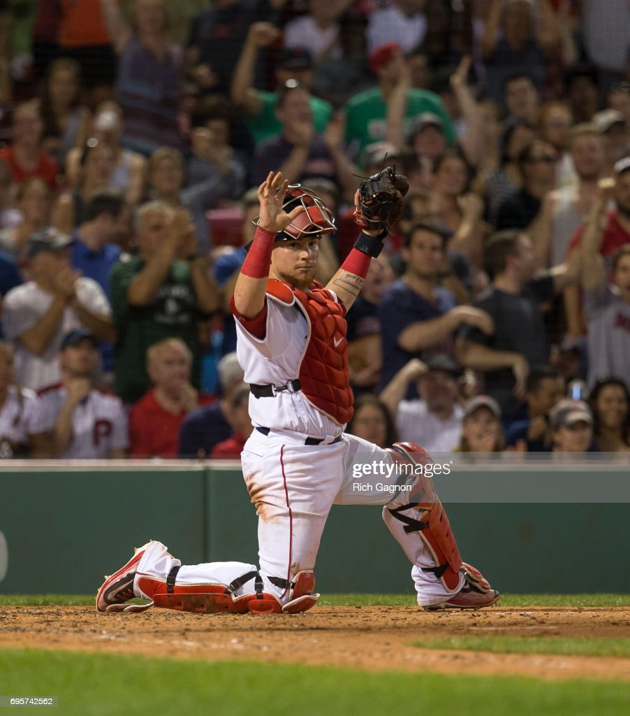 Christian Vazquez #7 of the Boston Red Sox hold up the ball after he applied a tag for an out on Howie Kendrick #47 (not pictured) of the Philadelphia Phillies on a throw from Andrew Benintendi #16 (not pictured) during the eighth inning at Fenway Park on June 13, 2017 in Boston, Massachusetts.
