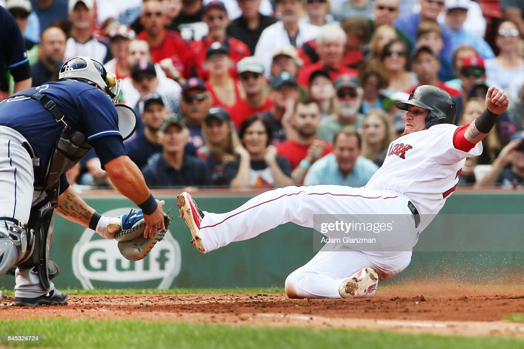 Christian Vazquez #7 of the Boston Red Sox is tagged out at home plate by Wilson Ramos #40 of the Tampa Bay Rays in the second inning of a game at Fenway Park on September 10, 2017 in Boston, Massachusetts.