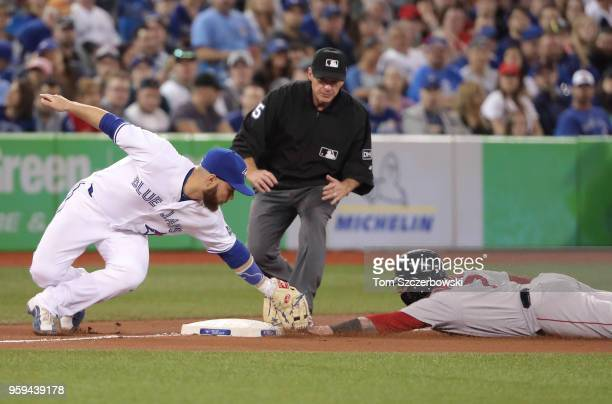 Christian Vazquez of the Boston Red Sox is tagged out at third base trying to steal in the seventh inning during MLB game action as Russell Martin of...