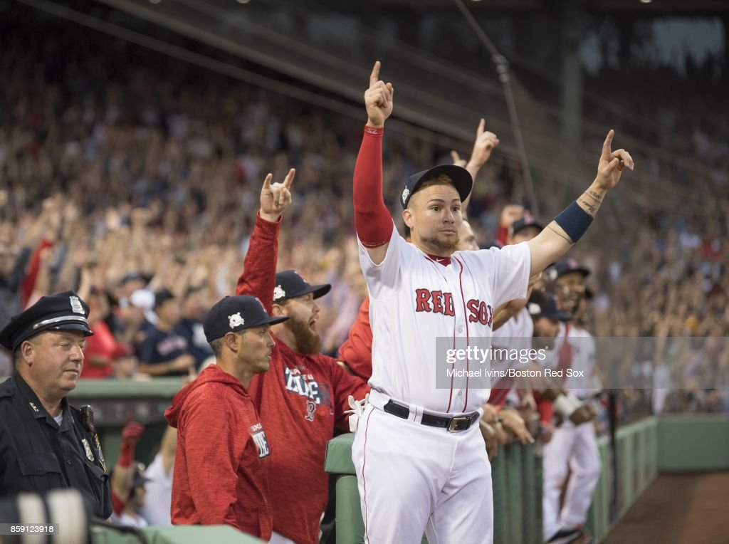 Christian Vazquez #7 of the Boston Red Sox reacts after a three-run home run by Jackie Bradley Jr. against the Houston Astros in the seventh inning of game three of the American League Division Series at Fenway Park on October 8, 2017 in Boston, Massachusetts.