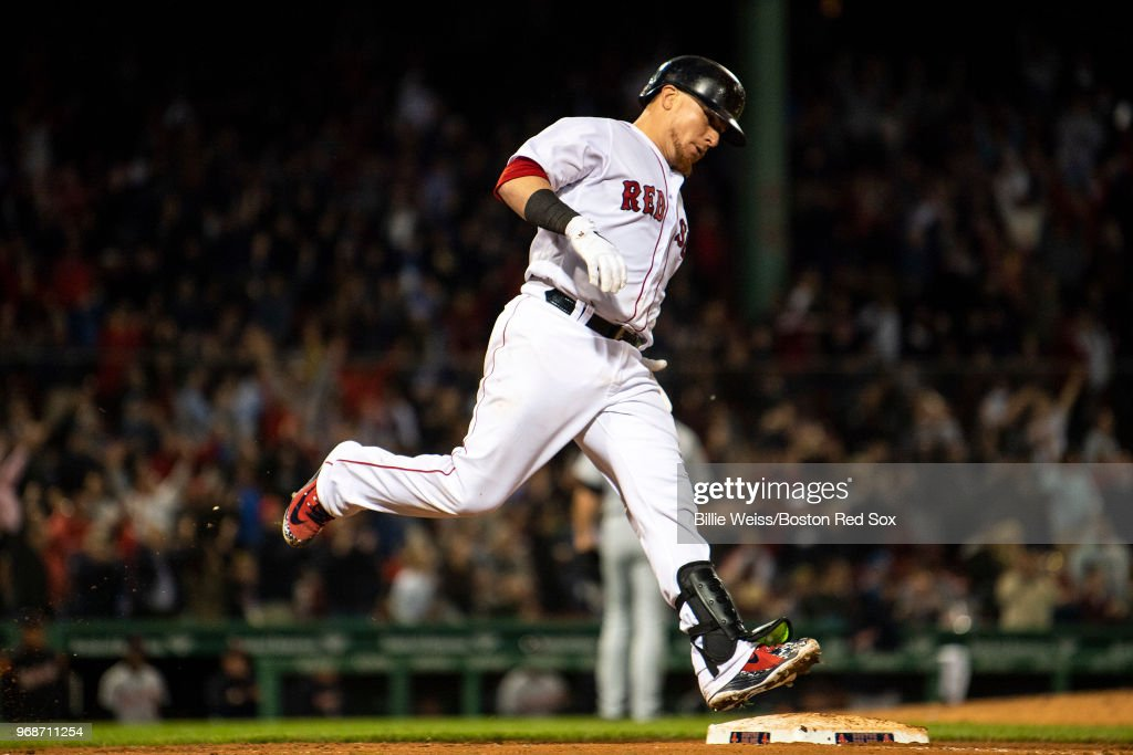 Christian Vazquez #7 of the Boston Red Sox rounds first base after hitting a solo home run during the seventh inning of a game against the Detroit Tigers on June 6, 2018 at Fenway Park in Boston, Massachusetts.
