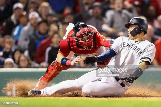 Christian Vazquez of the Boston Red Sox tags out Gary Sanchez of the New York Yankees at home plate in the seventh inning of a game Fenway Park on...