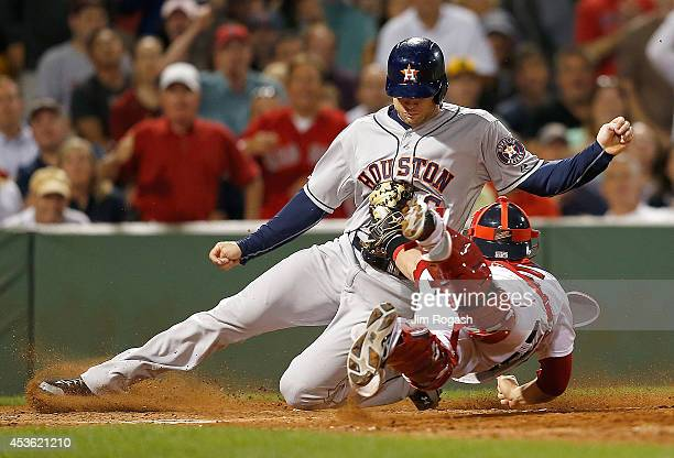 Christian Vazquez of the Boston Red Sox tags out Jake Marisnick of the Houston Astros trying to score in the seventh inning at Fenway Park on August...