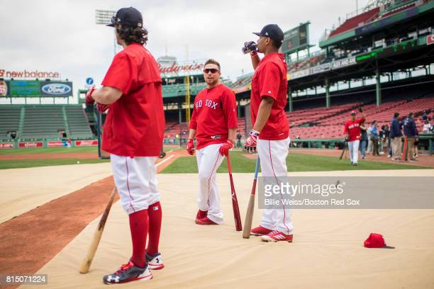 Christian Vazquez of the Boston Red Sox talks with Xander Bogaerts and Andrew Benintendi before a game against the New York Yankees on July 15 2017...