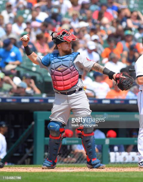 Christian Vazquez of the Boston Red Sox throws a baseball while wearing red white and blue catchers gear to honor 4th of July weekend during the game...