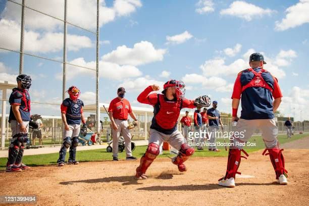 Christian Vazquez of the Boston Red Sox throws during a spring training team workout on February 26, 2021 at jetBlue Park at Fenway South in Fort...