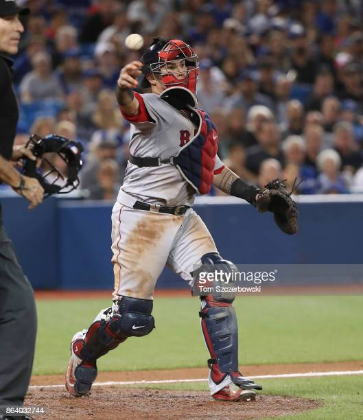 Christian Vazquez of the Boston Red Sox throws out the baserunner to complete the strikeout in the sixth inning during MLB game action against the...