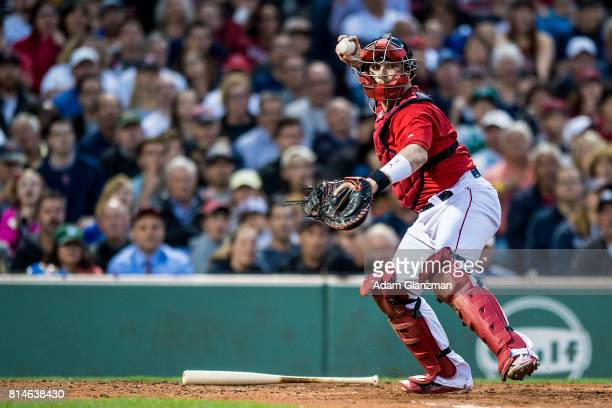 Christian Vazquez of the Boston Red Sox throws to first base to complete a double play during the third inning of a game against the New York Yankees...