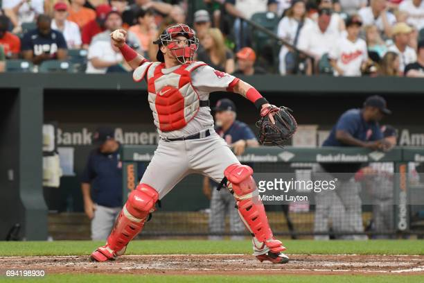 Christian Vazquez of the Boston Red Sox throws to second base during a baseball game against the Baltimore Orioles at Oriole Park at Camden Yards on...