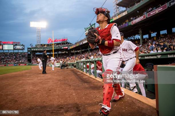 Christian Vazquez of the Boston Red Sox walks onto the field before a game against the Baltimore Orioles on April 11 2017 at Fenway Park in Boston...