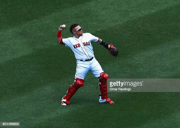 Christian Vazquez of the Boston Red Sox warms up before the game against the Kansas City Royals at Fenway Park on July 30 2017 in Boston Massachusetts