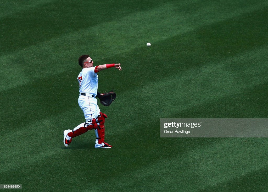 Christian Vazquez #7 of the Boston Red Sox warms up before the game against the Kansas City Royals at Fenway Park on July 30, 2017 in Boston, Massachusetts.