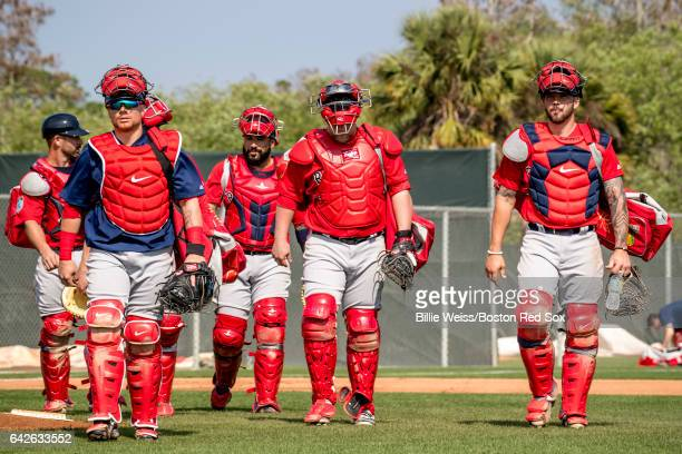 Christian Vazquez Sandy Leon and Blake Swihart of the Boston Red Sox walk during a team workout on February 18 2017 at Fenway South in Fort Myers...