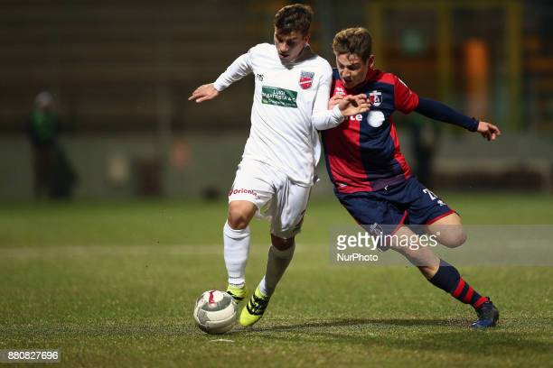 Christian Ventola of Teramo Calcio 1913 compete for the ball with Andrea Vallocchia of SS Sambenedettese during the Lega Pro 17/18 group B match...